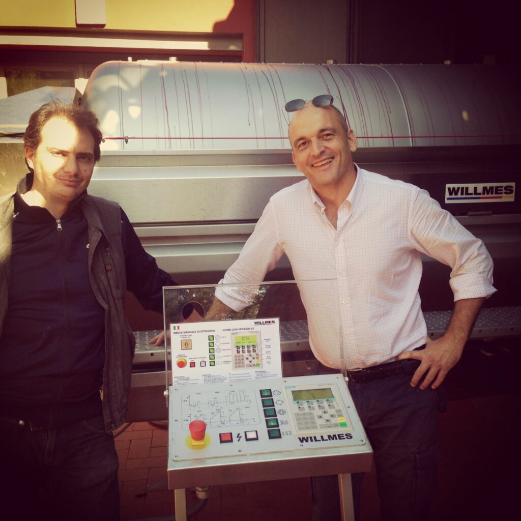 Roberto and Antonio in front of the new press